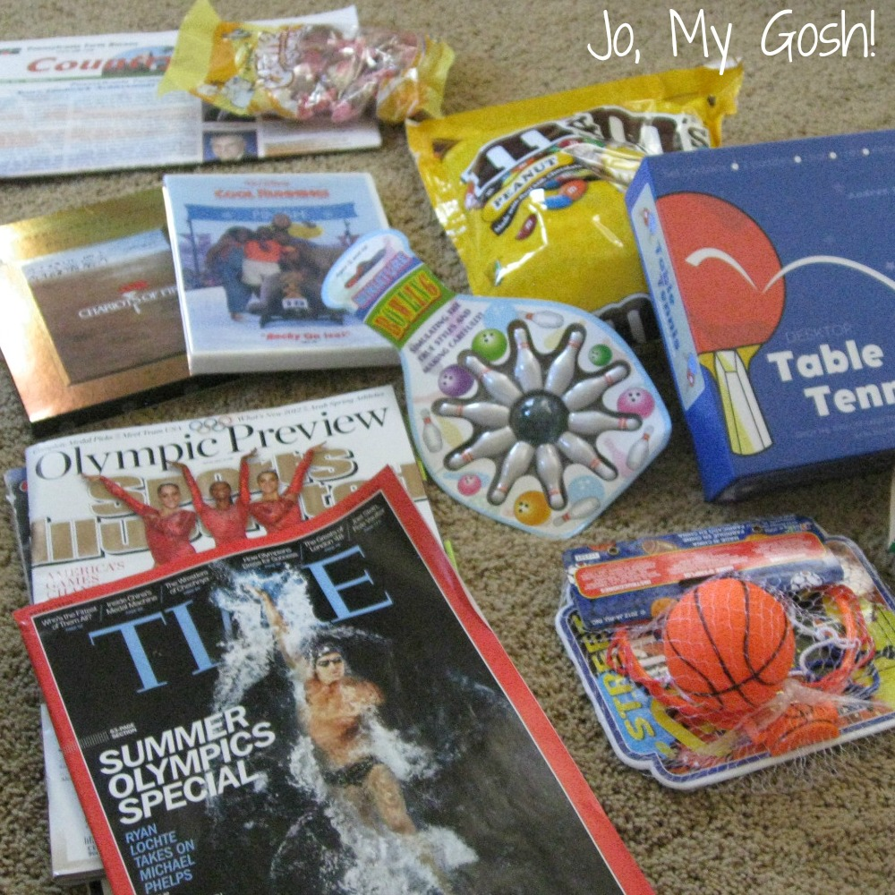 Send a care package full of sporty fun with this Olympic-themed gift. #inspiration #carepackage #military #militaryfamily #militaryspouse #sendmoremail #happymail #carepackages