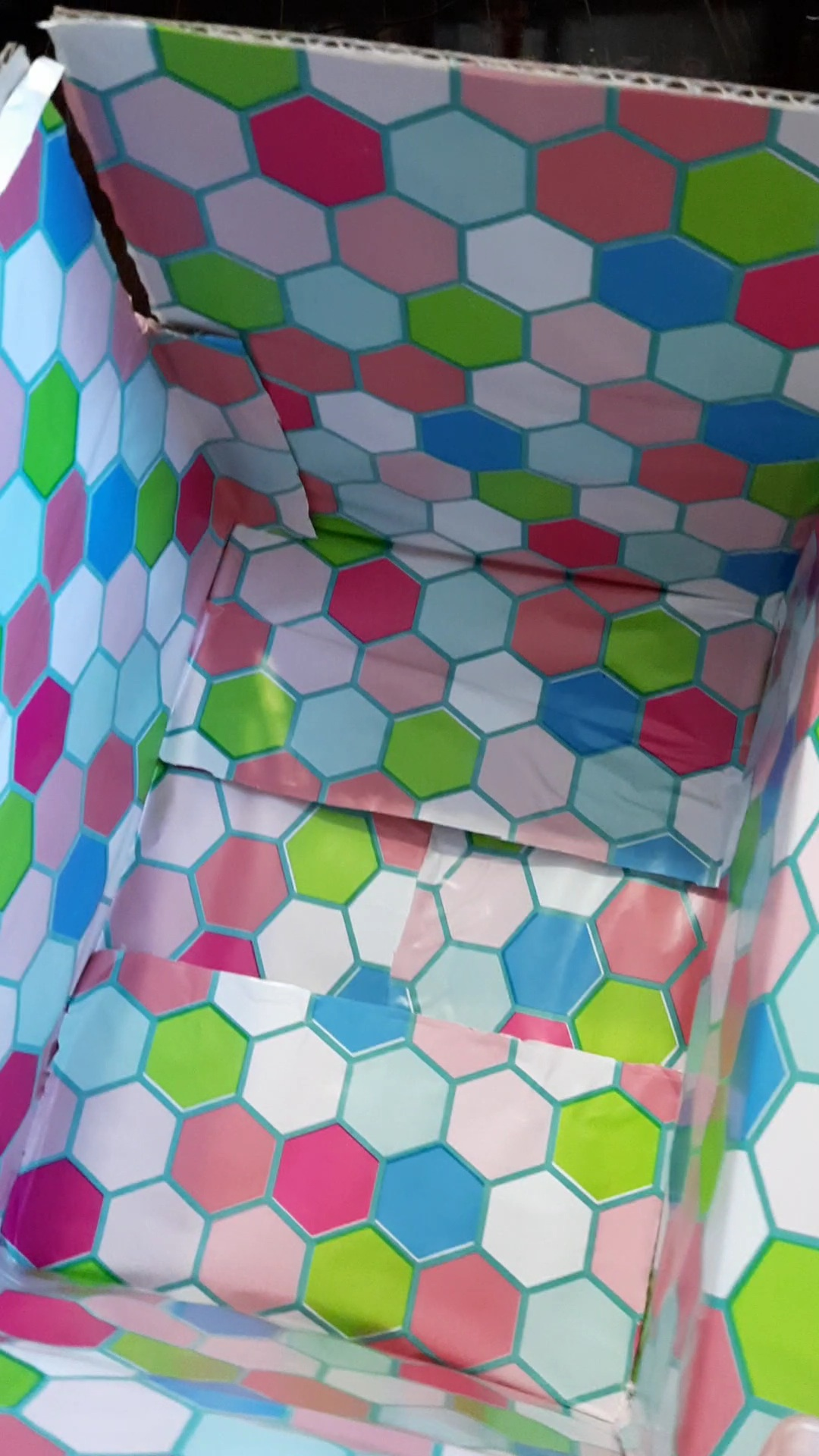 Here's how to easily wrap the inside of a box-- for gift giving or for care packages. This method is cheap, fast, and works on rectangular or square boxes. #carepackage #craft #crafting #wrapping #snailmail #deployment #christmasgifts